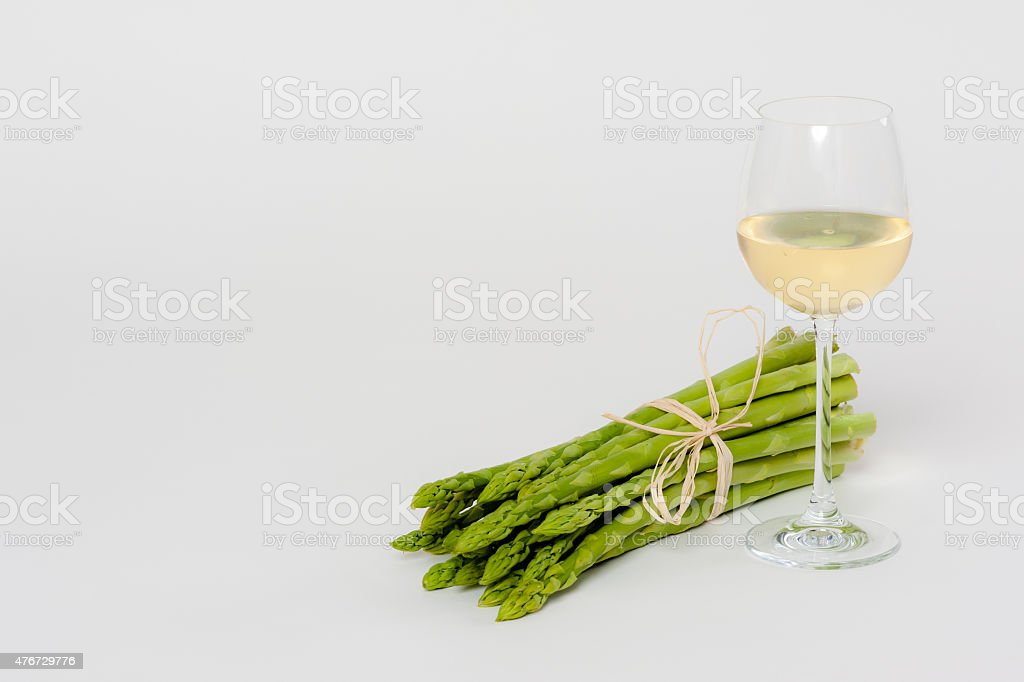 Green Asparagus with a Glass of White Wine stock photo