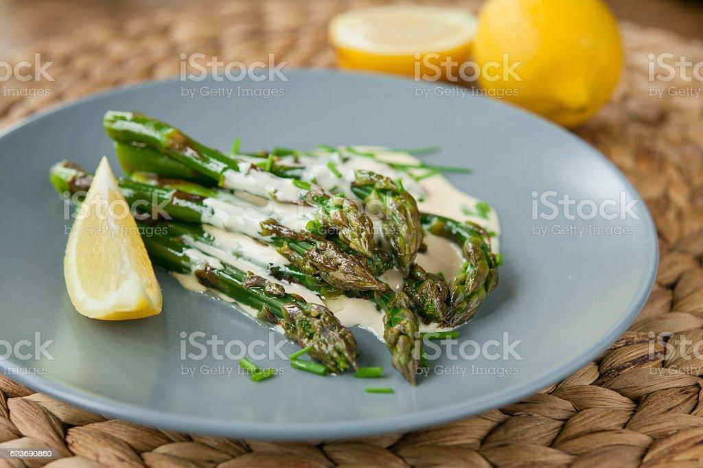 Green asparagus with butter  lemon sauce. stock photo
