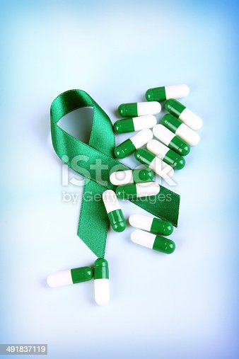 istock Green Awareness Ribbon with Capsules 491837119