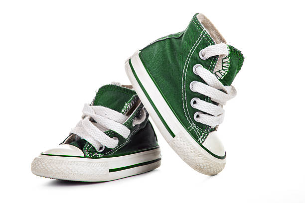 Green baby shoes stock photo