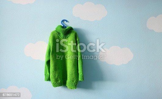 istock green baby sweater 678651472