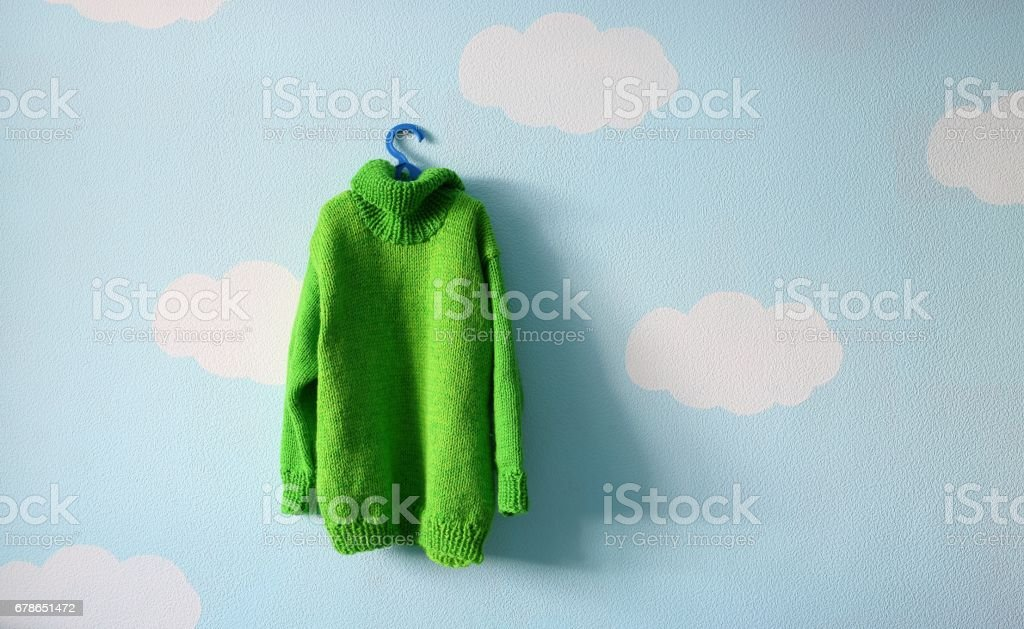 green baby sweater stock photo