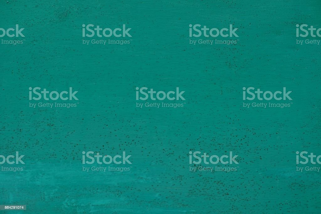 green background from a fragment of a metal wall royalty-free stock photo