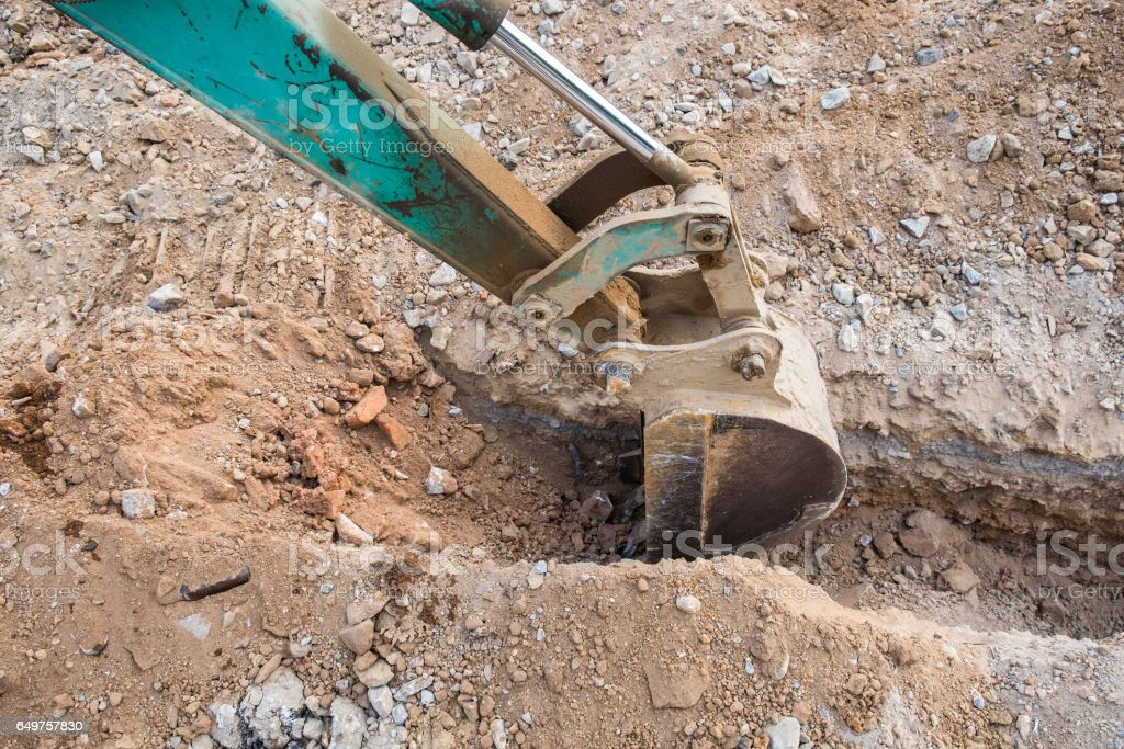 Green backhoe dredging soil stock photo