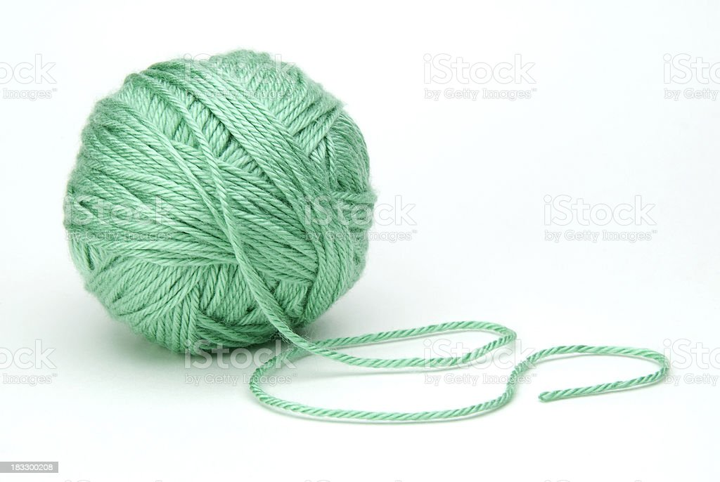 green ball of yarn on white background stock photo
