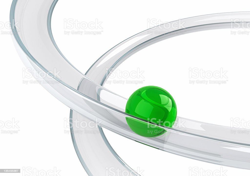 Green ball rolling down on the helix tray stock photo