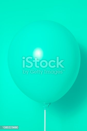 istock Green balloon on green background with shadow. Side glare. 1085325680