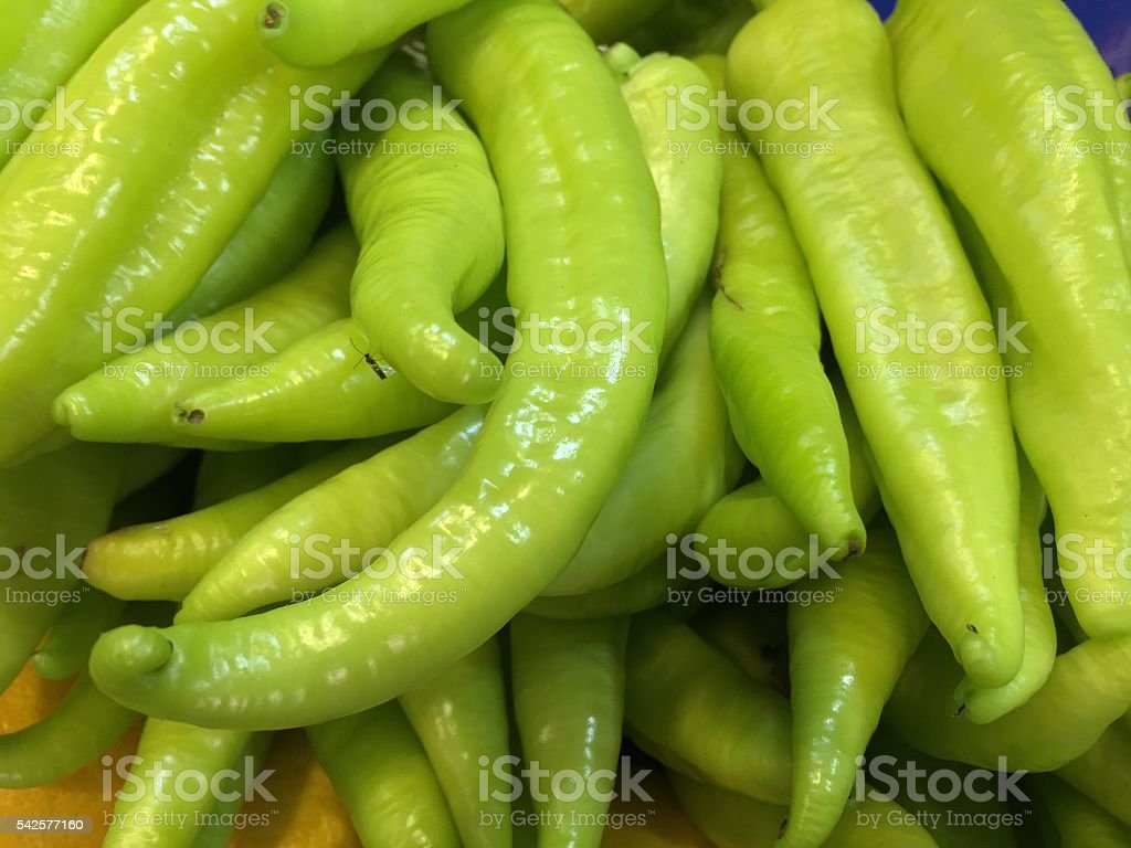green banana peppers as a background stock photo