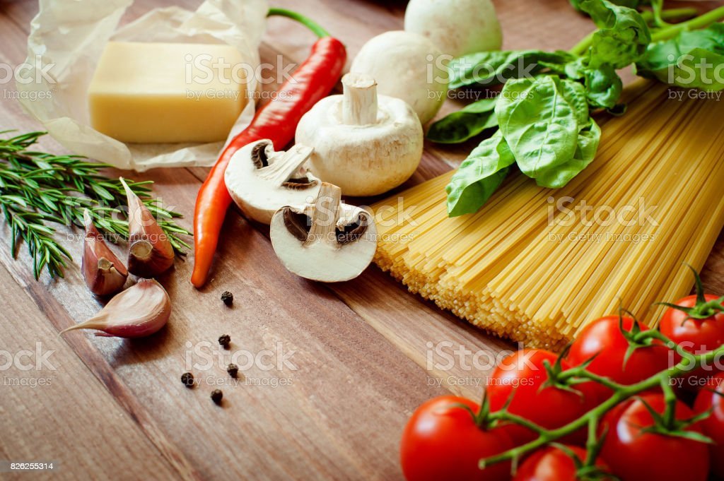 Green Basil in the background for pasta products stock photo