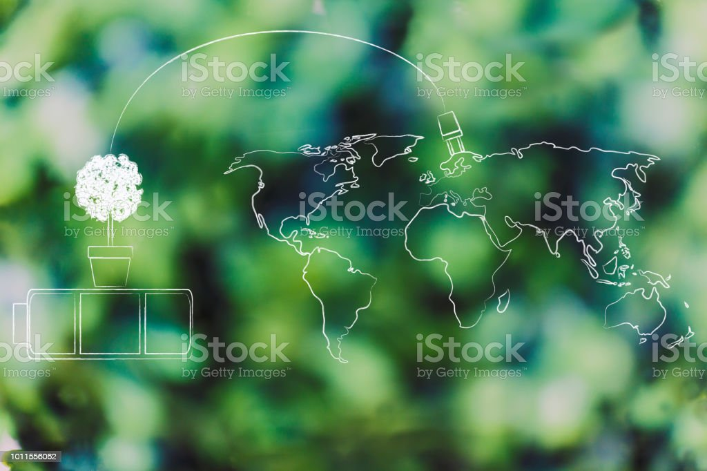 green battery with tree charging the world of renewable energy stock photo