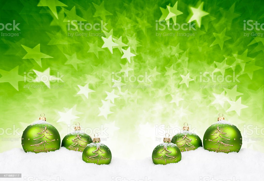 Green Baubles covered with Snow royalty-free stock photo