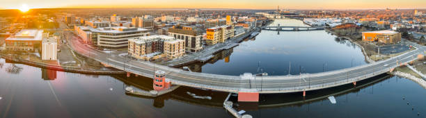 green bay's main street bridge reflected in still fox river - green bay wisconsin stock photos and pictures