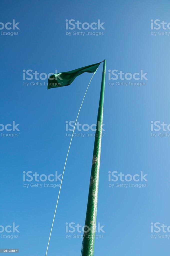Green beach flag royalty-free stock photo