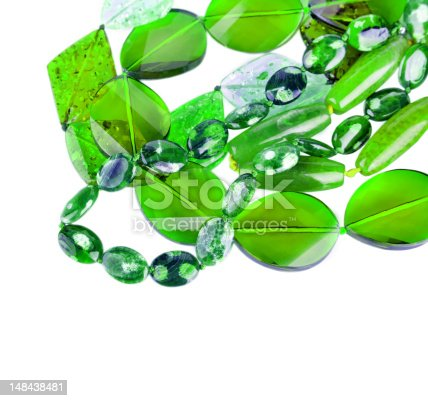 istock green beads from different minerals and stone background 148438481