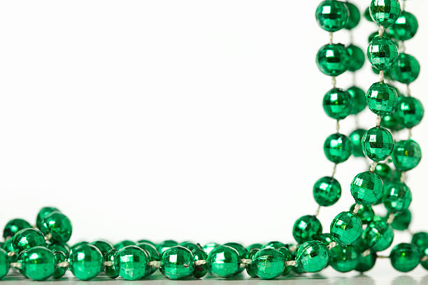 green beads - mardi gras borders silhouette stock photos and pictures