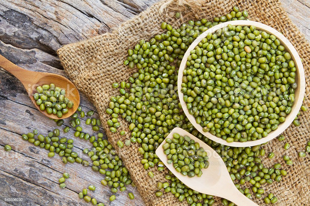 Green bean or mung bean in wooden bowl stock photo