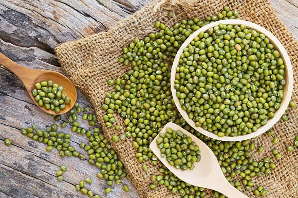 Green bean or mung bean in wooden bowl stock photo