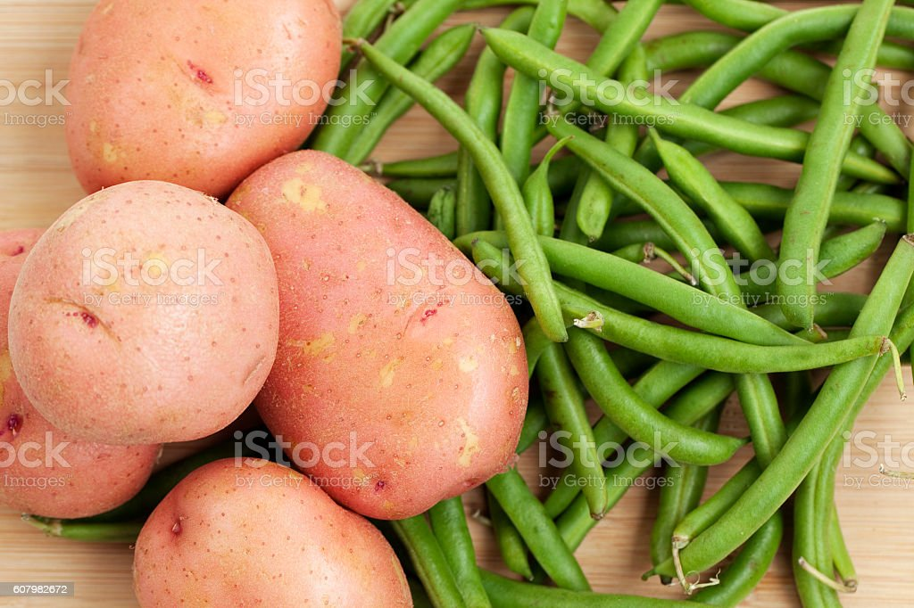Green Beans and Red Potatoes on Wood Background stock photo