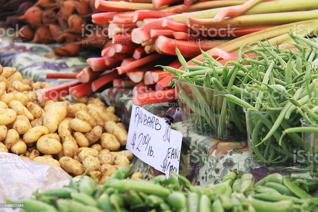 Green beans and rhubarb at farm market royalty-free stock photo