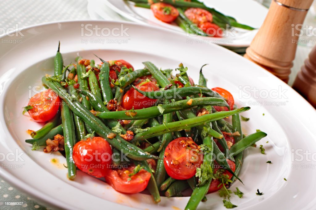 Green beans and tomato salad stock photo