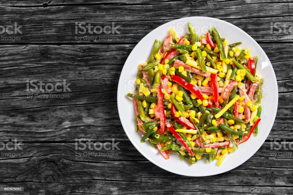 green beans, corn, ham and cheese salad stock photo