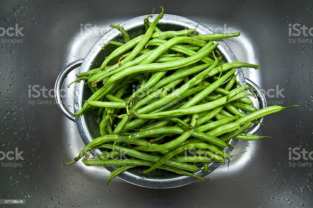 Green beans in a colander royalty-free stock photo