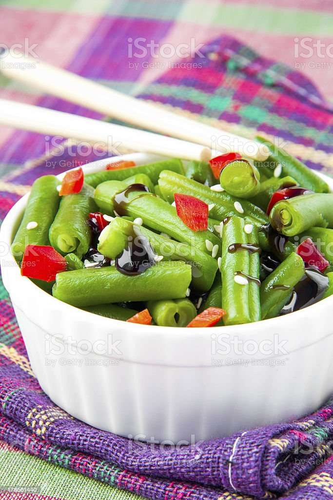Green beans in white cup with chopsticks royalty-free stock photo