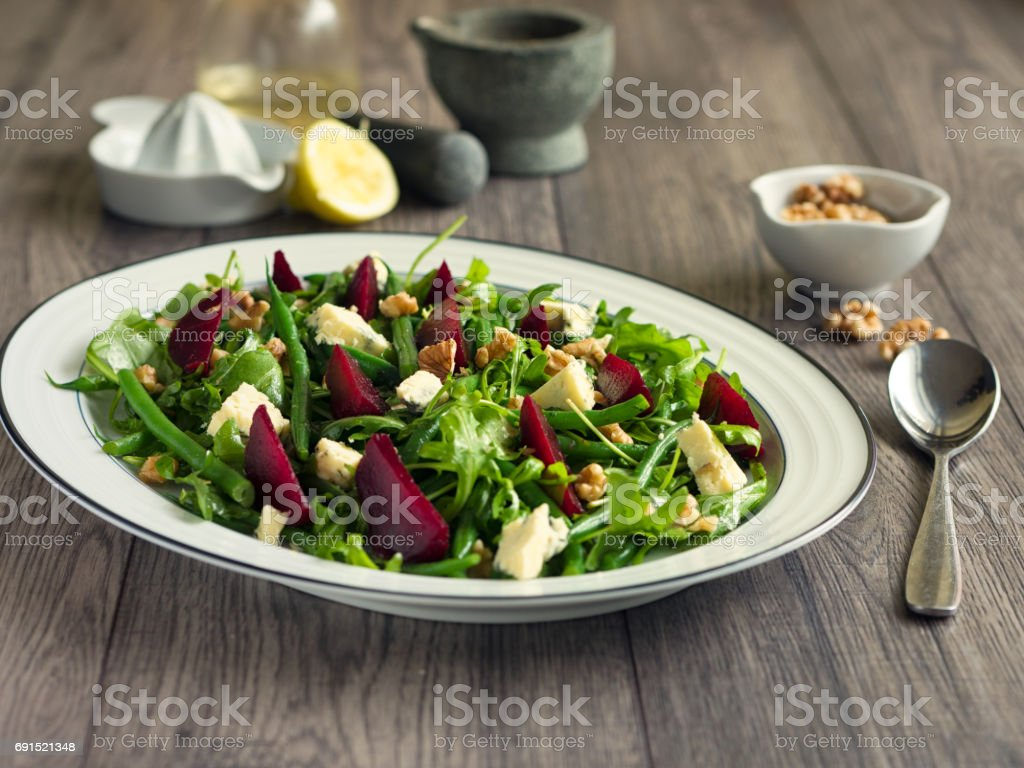 Green beans,rocket,beetroot salad with blue cheese and walnuts stock photo
