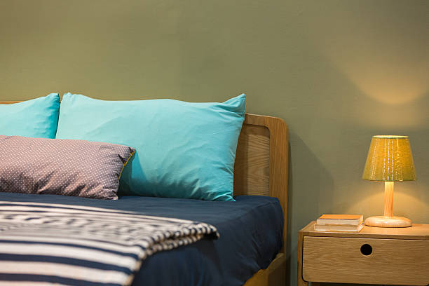 Green bedroom and bedding stock photo
