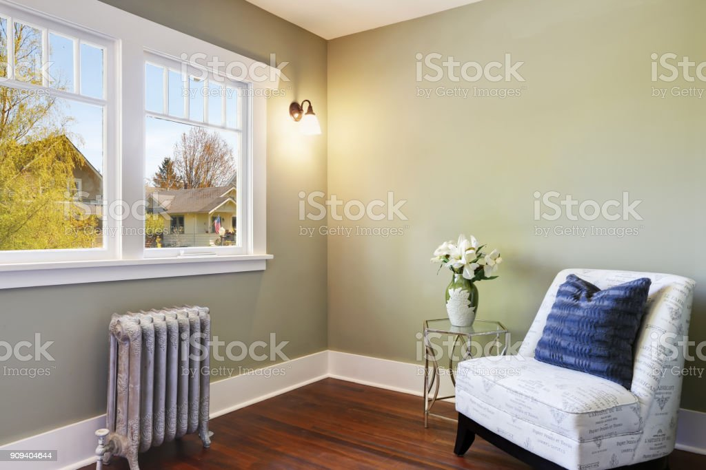 Green bedroom nook with an accent armless chair stock photo