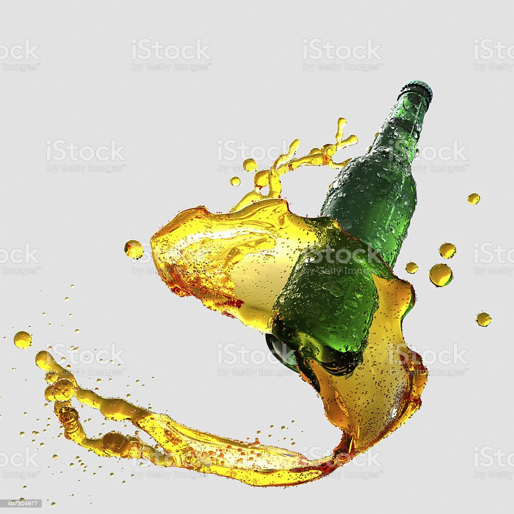 Green beer bottle with golden splash stock photo