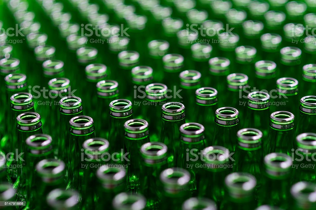 Green beer bottles in brewery stock photo