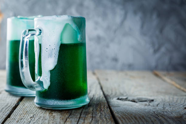 green beer in mugs on rustic wood background - st patricks day stock photos and pictures