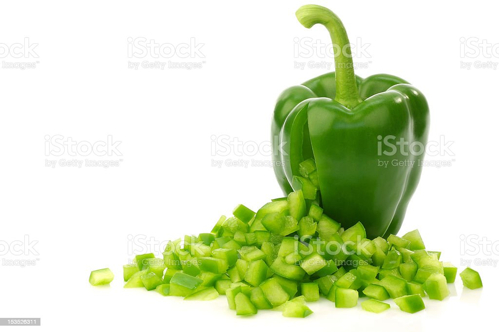 green bell pepper with cut pieces coming out stock photo