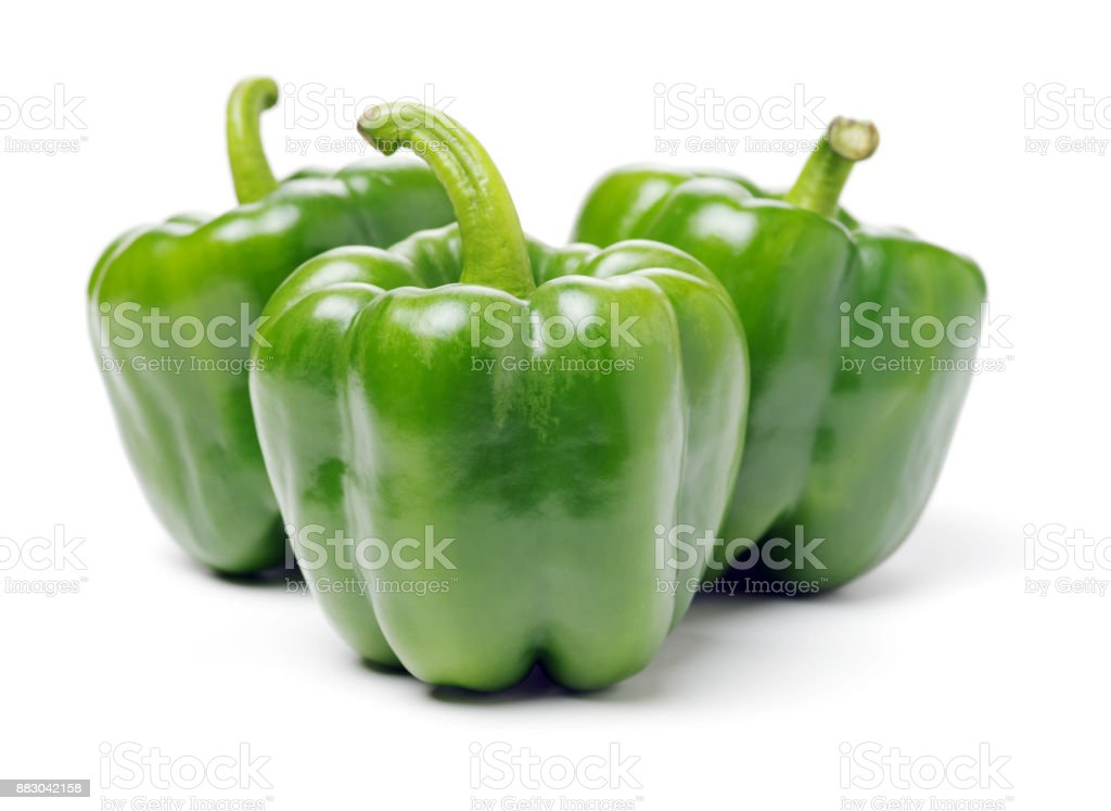 green bell peppers isolated on a plain white background stock photo