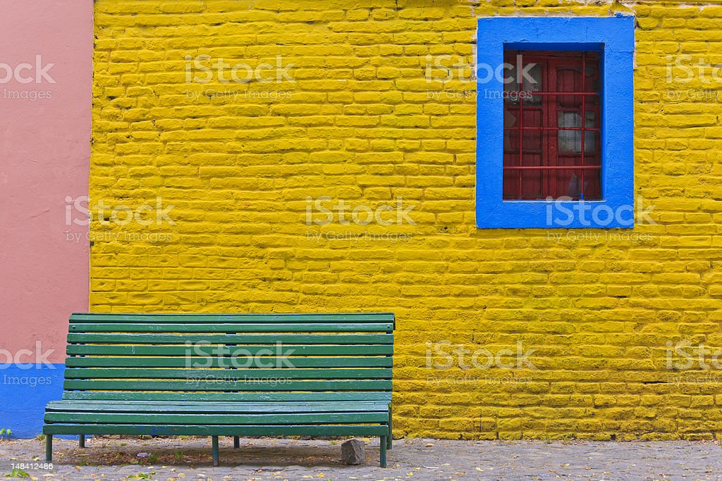 Green bench in Caminito street, La Boca stock photo