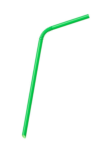 A green bendy drinking straw on a white background stock photo
