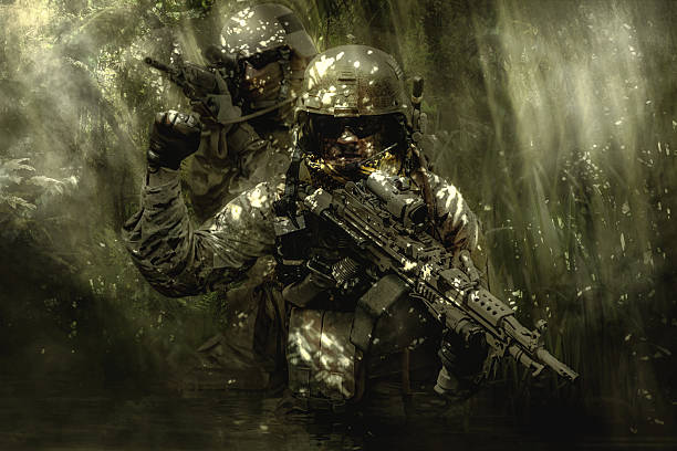 Green Berets soldiers in the jungle stock photo