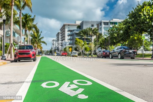 Green bicycle lane in the streets of Miami Beach, Florida.