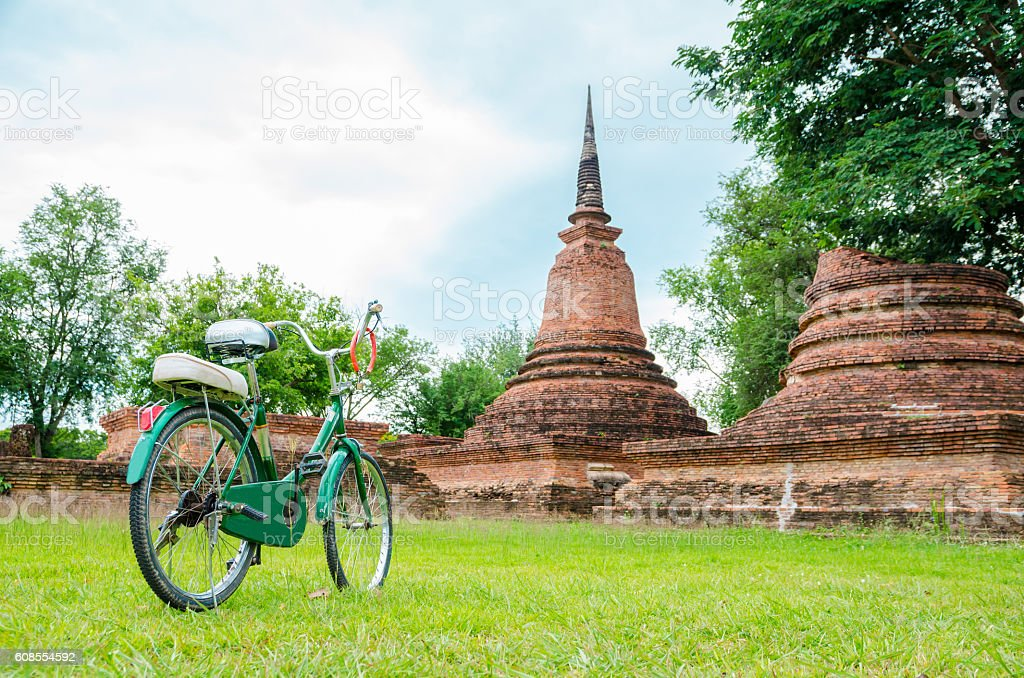 green bicycle with ancient temple stock photo