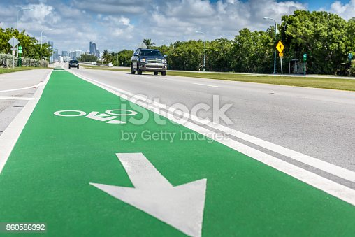 Green Bike lane protecting bikers on the road.