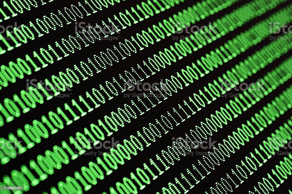 Green binary computer data code on screen of monitor royalty-free stock photo