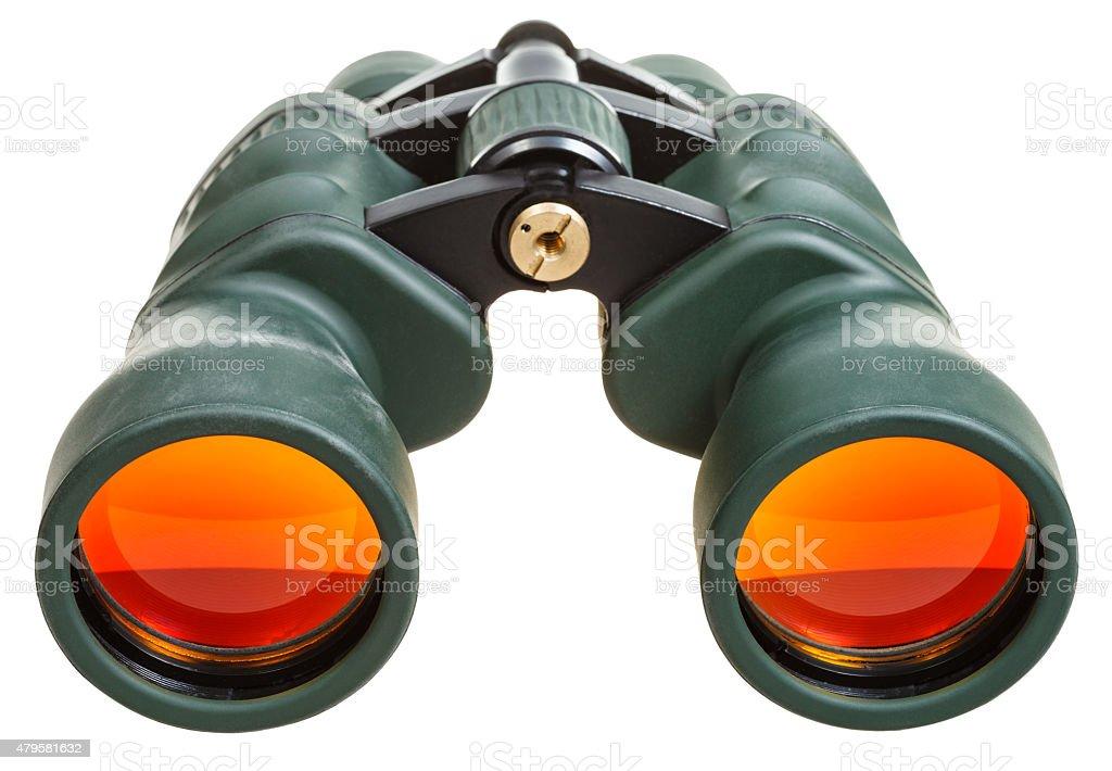 green binoculars with orange glasses isolated stock photo