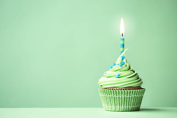 Green birthday cupcake Green birthday cupcake with copy space to side first birthday stock pictures, royalty-free photos & images