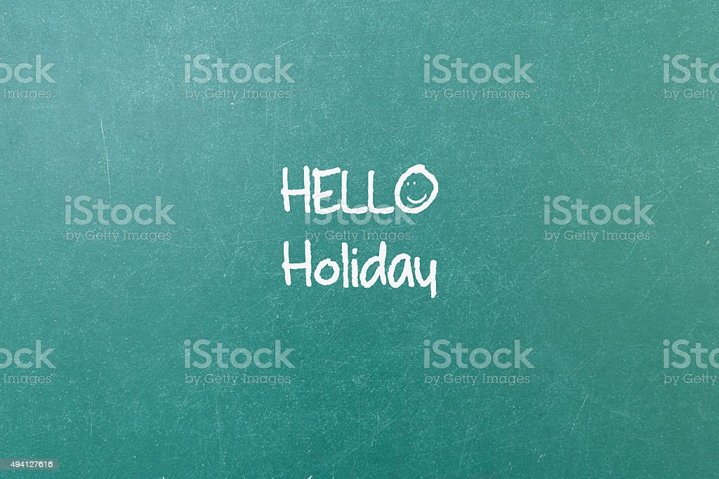 Green blackboard wall texture with a word Hello Holiday stock photo