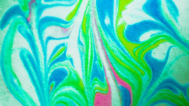 green blue and pink shaving cream paper marbling - shaving cream stock pictures, royalty-free photos & images