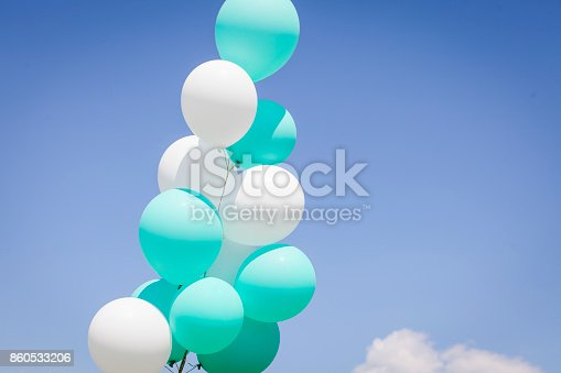 istock green, blue white balloons in the sky 860533206