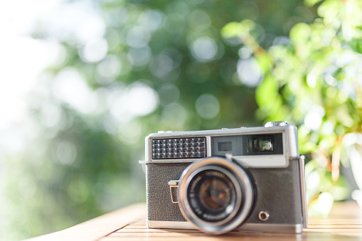 Green blur background and retro camera