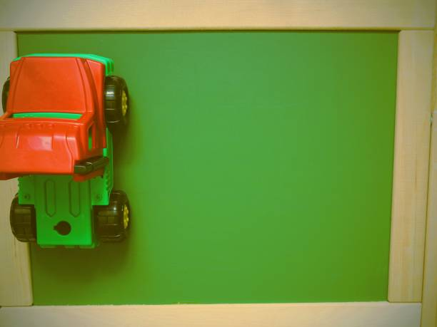 Green Board And Toy Car Top View Toned Image Stock Photo More