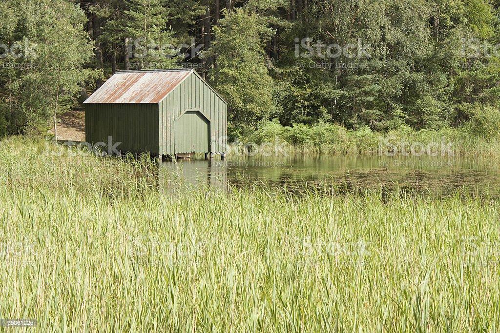 Green boat house stock photo